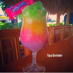Tipsy Bartender Watch us make a Drunken Vodka Popsicle Slushie: https://youtu.be/aCdIhWgEa6w LAFFY TAFFY DAIQUIRI Each Layer: 3 Laffy Taffys 1 oz. (30ml) Rum 1/4 oz. (7ml) Simple Syrup Ice Blend www.youtube.com/TipsyBartender INSTAGRAM PHOTO CREDIT @lanas_tails
