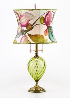Lana Table Lamp by Susan Kinzig and Caryn Kinzig. Lana is a striking lamp with colorful blown glass and a vibrant curvy shade splashed with green, purple, teal colors in an abstract floral design Lana has a double bulb socket and ships with two bulbs. Chandelier Lamp, Chandeliers, Lamp Light, Light Up, Style Cottage, Lampe Decoration, Fusion Art, Traditional Lighting, Brass Lamp