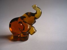 Fenton Glass Elephant amber color Figurine Free by SusanSorrentino