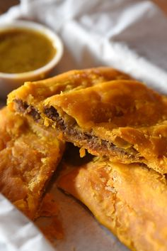 Its delicate crust is flaky and golden, its ground beef punctuated with kicks of Scotch bonnet, black pepper, onion and garlic. The Jamaican beef patty has made its way out of Jamaican kitchens and bakeries, to immigrant enclaves and bodegas, and into major retailers like Walmart and Costco. (Photo: Anna Petrow for The New York Times) http://nyti.ms/2qxEuVf
