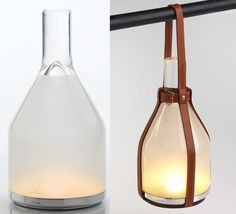Solar powered lamp with leather hanging straps by Edward Barber and Jay  Osgerby