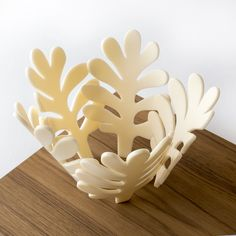 Plate, kit with basement in natural solid Teak and leaves in blue or ivory-white plexiglas.  Year 2013