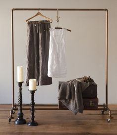 Copper rolling clothes rack. Could be an easy furniture DIY.  I made a copper pot rack from pipes, it was easy!
