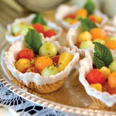 Fruit Salad Cups with Spiced Cardamom Syrup served in a candy-coated waffle bowls