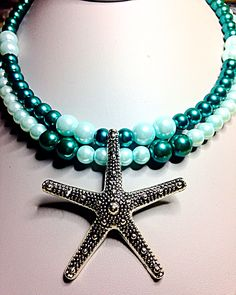 Silver starfish on a double strand of sea colored glass pearls
