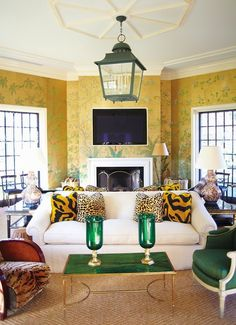 Mrs. Blandings: Trending...i love the pillows on the white sofa...the green topped coffee table...the rest I could leave.
