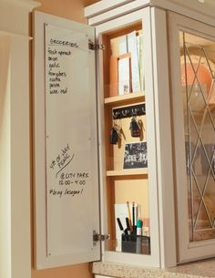 The Wall Message Center stores and organizes keys, papers, and other small items to keep countertops free of clutter. Also features magnetic whiteboard, key hooks, and pencil holder. By Thomasville Cabinetry.