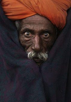 A camel herder poses for a portrait in Pushkar