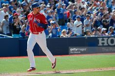 Toronto Blue Jays shortstop Troy Tulowitzki (2) comes home on the Upton Jr. double. Toronto Blue Jays V Minnesota Twins in MLB action at Rogers Centre. The Jays sweep the series and with today's game 9-6. Josh Donaldson hit 3 home runs (4 RBI) on the day. Toronto Star/Rick Madonik