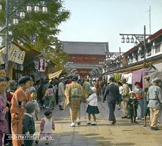1934, Tokyo.  This photo of a crowd walking past shops along the approach to the Buddhist temple Senso-ji was taken some time in May 1934. Notable is that while most men and even the children already wear Western clothing, the women still wear kimono. The shops, called Asakusa Nakamise (浅草仲見世) were a great crowd pleaser as can be seen on this photo.