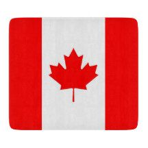 Small glass cutting board with flag of Canada