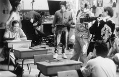 """Francis Ford Coppola (center right) rehearses a scene with Jennifer Lopez and Robin Williams (far left) on the set of """"Jack"""", 1996. Francis Ford Coppola, Bill Cosby, I Miss Him, Robin Williams, Scene Photo, Love Movie, Jennifer Lopez, Actors & Actresses, Behind The Scenes"""