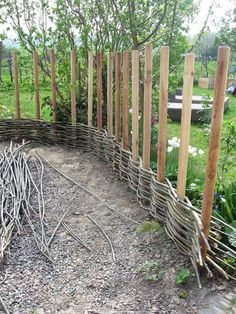 "Okay, this idea would only work if you have access to long, thin branches. And not any branch will do. They need to be ""green"". That means that there are fairly fresh and easily bent. But if you can get them, use the branches to weave a basket style fence like this. Super cool idea!"
