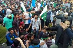 Protestors wave Pakistani flags in held Kashmir over oppression by India