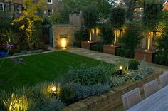 Harpur Garden Images :: Contemporary modern minimal stylish family urban town garden with lighting light lawn brick wall water feature lip cascade bay tree Laurus nobilis low brick wall raised bed border October autumn standard Contemporary, modern Back Gardens, Small Gardens, Outdoor Gardens, Landscape Design, Garden Design, Pinterest Garden, Porche, Family Garden, Garden Images