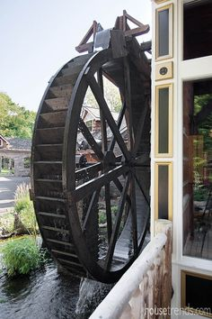 This 14-foot working water wheel was custom made in South Carolina for this Ohio home. #housetrends