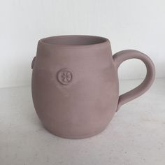 Greenware mug ready for the bisque fire. New mug and handle shape on this one as well as some little sprigs that will play up the shino glaze.