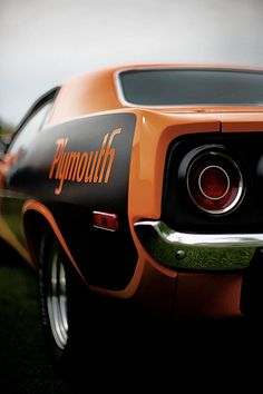 Plymouth Barracuda  That is perfection. I wonder if I could french a cuda rear bumper on a 72 duster front end and use small round projector headlamps to mimic the rear layout of the cuda.