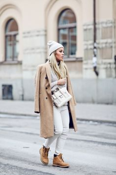 Angelica Blick's timberland outfit consists of beige trousers, a matching knit sweater and a stylish double breasted camel coat; combining multiple in trends. Coat/Trousers: Zara, Knit: Gina Tricot, Boots: Timberland, Bag: Phillip Lim.