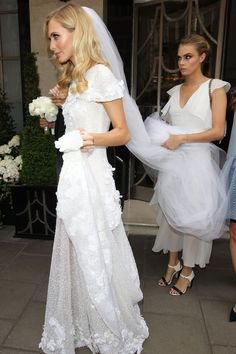 'The bride wore Chanel' -  Poppy Delevingne's natural curls are perfect for her gorgeous dress!