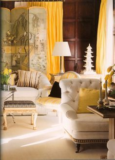 Glowing yellow touches are everything in this interior by Mary McDonald.