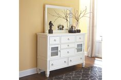Fresh, crisp and classic. Whether you're going for shabby chic or cottage quaint, the Prentice dresser and mirror set is dressed to impress. Multiple drawers help you organize your wardrobe beautifully. The option of frosted glass inlays give the cabinet door fronts a whole new appearance.