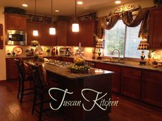 The Tuscan Home... A little too crowded for me on the countertops, but good ideas above the cabinets.