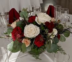 With roses, spray roses, mums, carnations, agonis foliage and eucalyptus greens.