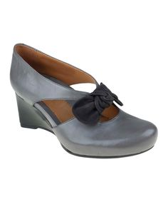 Dark Gray Bristol Wedge - Earthies. The comfort of Earthies shoes all wrapped up in a posh little package. Flawless leather and a stacked wood wedge add support to the refined styling of this bow-topped shoe. Elastic stretches so this pair slips right on.