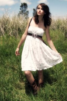 Love white dresses and cowboy boots