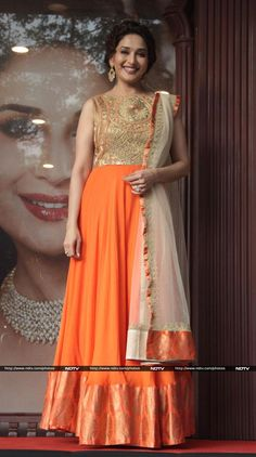 Madhuri looked beautiful in a bright orange floor length anarkali by Pankaj and Nidhi at a jewellery event in Mumbai http://movies.ndtv.com/photos/32-all-out-madhuri-sonam-16445