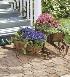 Decorative Solid Wood Wheelbarrow Planters - love these! - these are by Plow & Hearth #planter #wheelbarrow
