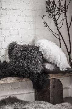 Tibetan sheepskin cushions plus rug.