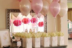 """""""For the party favors, we put together bags filled with 'things that go pop,' which included mini champagne to pop open on the baby's due date, Pop Rocks, gumballs, kettle popcorn and cake pops,"""" says Cristina of Le Partie Sugar."""