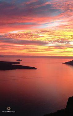 Views over the Santorini Volcano at sunset. For luxury hotels in Santorini visit http://www.mediteranique.com/hotels-greece/santorini/