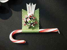 Cute way to dress up a candy cane. Need to remember this for co-workers next year.