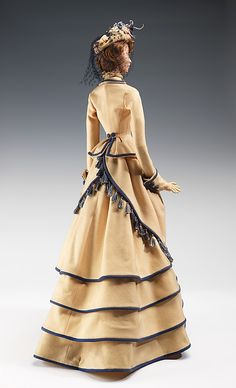 """""""1876 Doll""""  Jacques Heim  (French, 1899–1967)  Designer: Guillaume Date: 1949 Culture: French Medium: metal, plaster, hair, wool, feather, silk Dimensions: 31 x 12 in. (78.7 x 30.5 cm) Credit Line: Brooklyn Museum Costume Collection at The Metropolitan Museum of Art, Gift of the Brooklyn Museum, 2009; Gift of Syndicat de la Couture de Paris, 1949 Accession Number: 2009.300.730a–c"""