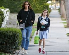 Staying close: The 44-year-old and her eldest child coordinated in glasses and black cardi...