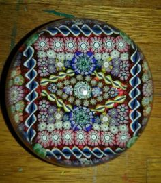 A fabulous limited edition Perthshire Paperweight from 1991. A very unusual squared pattern. Size is 3 in. Diameter. 1991 date cane set in the bottom of the red ground. Wonderful colors. Condition is