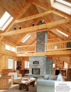 great room of a timber frame house by leila.D.leon