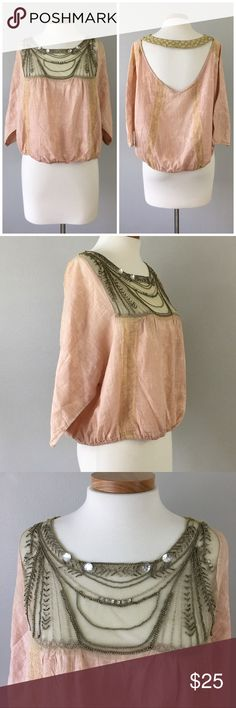 Free People Boho Beaded Oversize Blouson Blouse Free People Boho Beaded Oversize Blouson Blouse. Size small.  Gorgeous blouse! Thank you for looking at my listing. Please feel free to comment with any questions (no trades/modeling).  •Condition: GUC, no holes or stains.   ✨Bundle and save!✨10% off 2 items, 20% off 3 items & 30% off 5+ items! JB Free People Tops Blouses