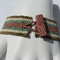 I live in the desert southwest and wanted to share some of our colors with you. Whether you wear this to work, to dinner, or to the nightclub, this bracelet wont get in the way. It weighs so little you may actually forget youre wearing it...but not for long because everyone else will
