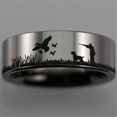 Duck Hunting Scene Ring Please read before buying: Tungsten Carbide is highly scratch resistant, and will resist abrasions better than any other metal, but should not be considered scratch proof. Perh
