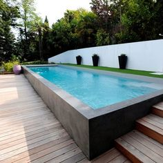 A Raised Lap Pool With A Water Fall Is The Main Feature Of