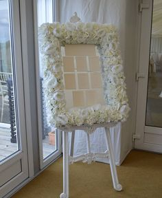 Our classic floral mirrored table plan frame