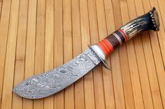 """Damasteel """"Stainless Damascus"""" with a stacked crown sambar stag handle."""