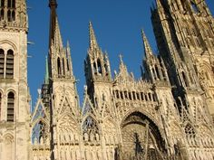 """Rouen has been dubbed the """"City of a Hundred Spires,"""" for many of its important edifices are churches. Towering above them all is the highest spire in France, erected in 1876, a cast-iron tour-de-force rising 490 ft above the Cathédrale Notre-Dame de Rouen. Claude Monet immortalized Rouen's cathedral facade in his paintings."""