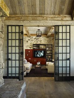 Rustic Tuscan Spanish media room. Love the doors and the room that the photo is taken from. I love the rustic Disneyland feel. Stone wood every detail is thought of. Artistic!
