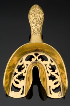 *DENTAL IMPRESSION TRAY's:  made moulds of the mouth . The were introduced in the mid-1800's. A Model of the mouth was obtained by biting on a moulding material placed in the tray. The dentist used this as a template to create a set of dentures. This impression tray is made of bronze. Similar, although less elaborate, trays are used today. France, c1830-1850