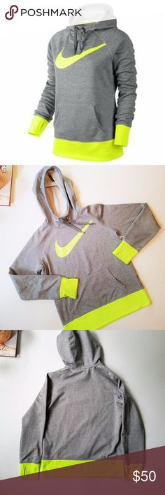 Nike Big Swoosh All Time Therma-FIT Fleece Hoodie Take on cold weather in stride in this women's Nike hoodie, featuring insulating Therma-FIT technology to keep you warm and comfortable.  Product Features:  Moisture-wicking technology.  Nike Swoosh logo.  Drawstring hood. (see lace ends last pic) Thumb holes.  Soft fleece design.  Long sleeves. 1-pocket.  Neon yellow/green and heathered grey Condition: there are some signs of wear on the yellow part, very hard to see (see pics 4 and 5)…